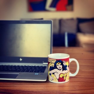 Tuesday, May 5, 2020 – Working from home with two kids for 8 weeks takes the strength of Wonder Woman. I channeled it through my mug (bought in the US several years ago). Rome, Italy. Lauren Phillips