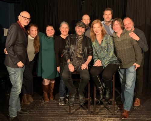 Andrea Wojnicki onstage with Monkey Toast improv actors