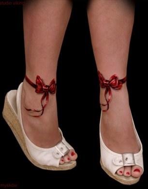 tatuagem feminina 3d laço vermelho