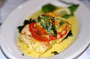 Poached Halibut over Spinach, Saffron Heirloom Tomato Sauce