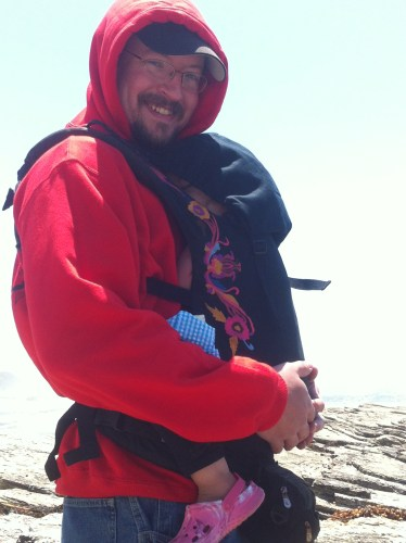 Keeping a llittle girl warm at the windswept, freezing cold Montana De Oro side trip.