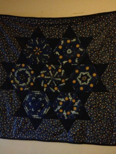 Birth quilt by my grandma on wall of boys' room.