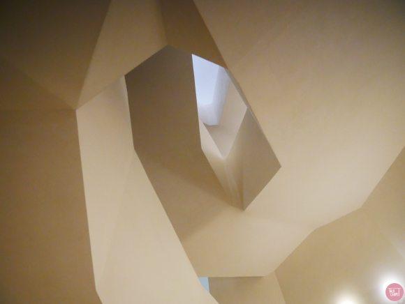 minimal custom carpet, Minimal angular staircase draws the lines of this custom carpet