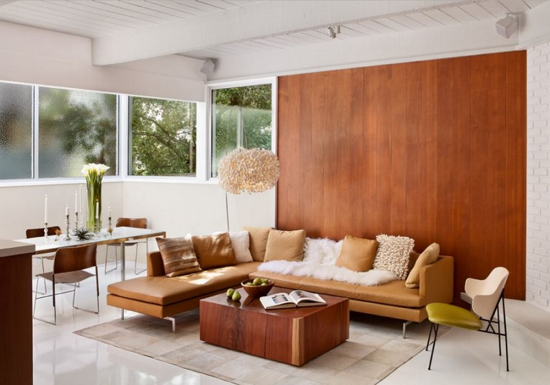 Vertical Wood Paneling Next To A White Brick Wall