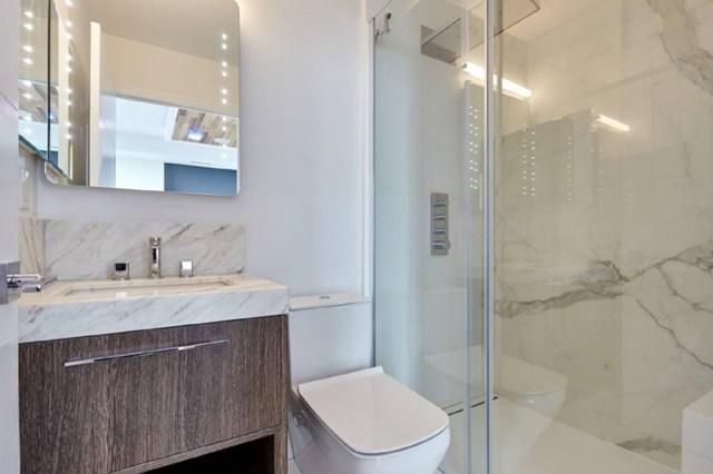 Condo Bathroom With Contemporary Mirror