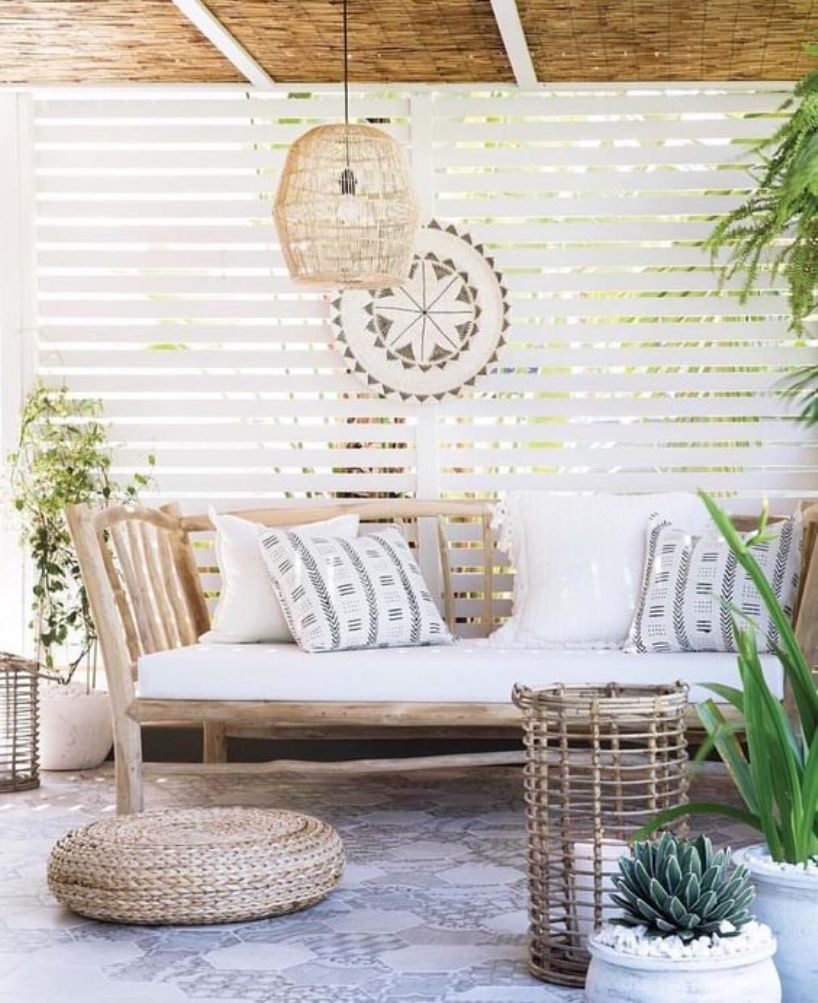 Tropical Patio With A Rustic Wooden Bench