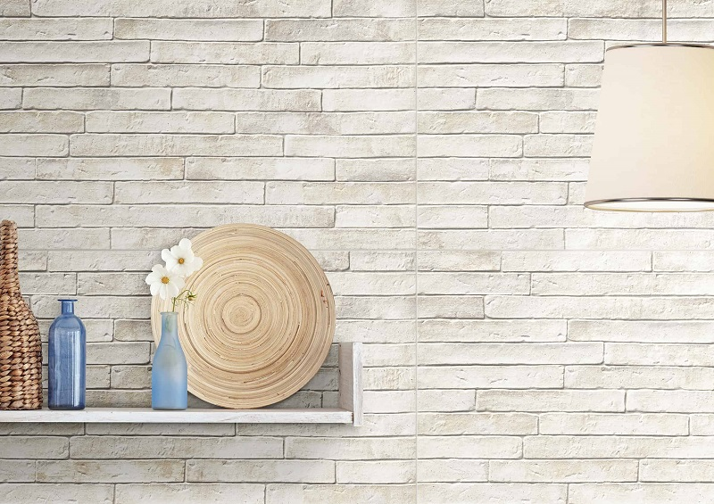 White Brick Wall With Wooden Plate And Flower