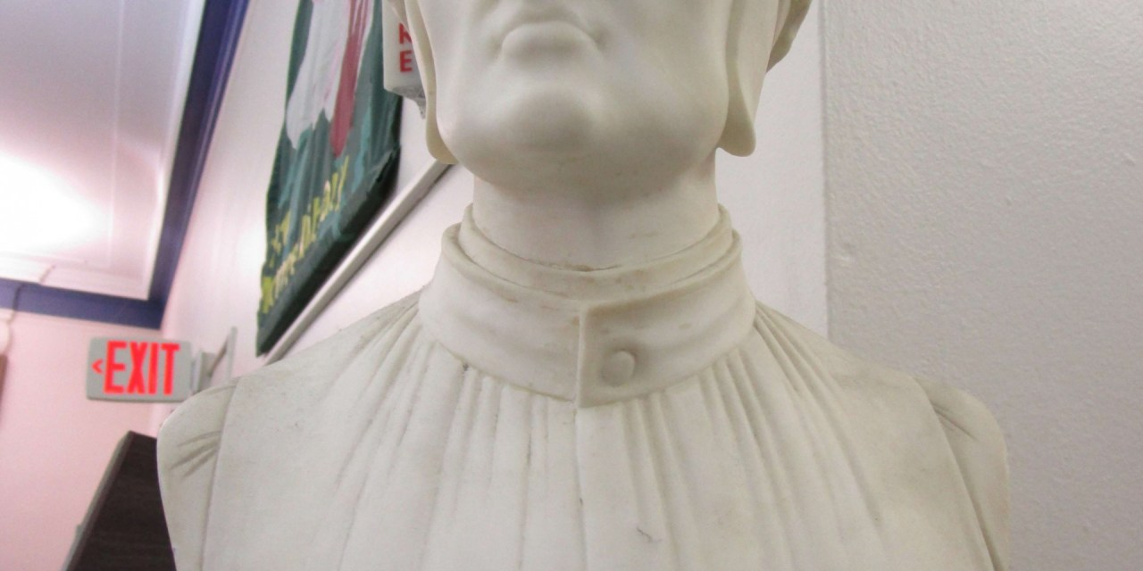 On Dante's bust on Monroe Avenue