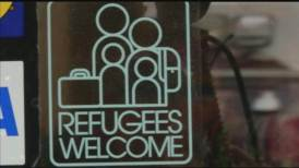 Business_owner_uses_stickers_to_support_refugees-syndImport-050639