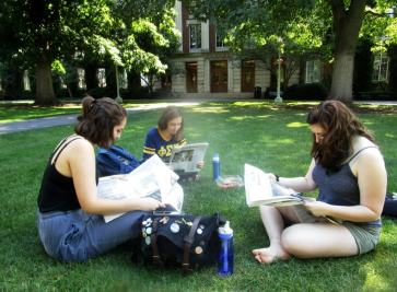 For (l-r) Abigail Milner, Susana Zamora, and Michelle Ficalora no time spent on the Quad is complete without the newspaper 9/13/16