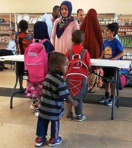 kids getting back packs