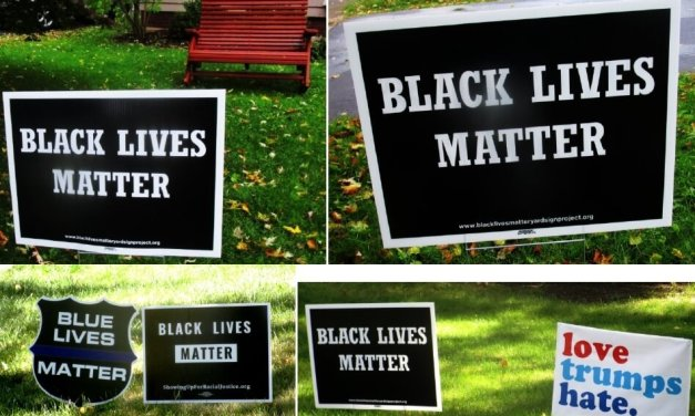 An anti-racism vigil and Black Lives Matter signs in Brighton