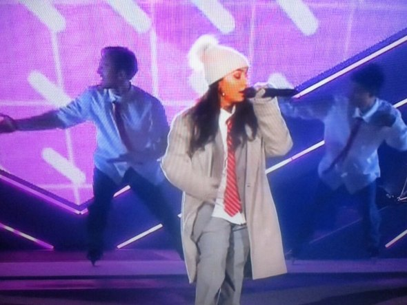 Canadian singer and songwriter Alessia Cara performing at halftime.
