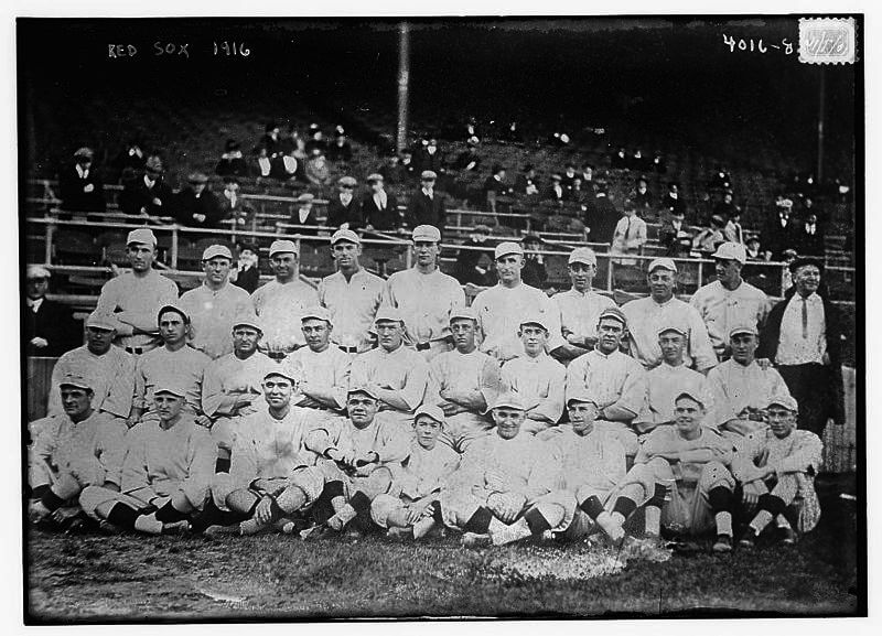 Group portrait of the Boston Red Sox, American League Champions, 1916. Front row, left to right: Hoblitzel, Pennock, Shore, Babe Ruth, 'Red' Glennon, team mascot, Mays, Shorten, Leonard and McNally. Middle row, left to right: Walsh, Hooper, Foster, Thomas, manager, Carrigan, Walker, Janverin, Cody, Scott and Gardner. Back row, left to right: Jones, Wagner, Lewis, Gainer, Gregg, Agnew, Barry, Hendrickson, Wycoff, and 'Doc' Green, trainer. (Photo by Library of Congress/Interim Archives/Getty Images)