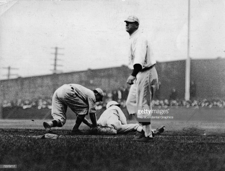 BOSTON, MA - OCTOBER 7, 1916: Duffy Lewis, outfielder for the Boston Red Sox, slides safely back to first base in the second inning of Game 1 of the 1916 World Series on October 7, 1916 at Fenway Park in Boston, Massachusetts. (Photo by Mark Rucker/Transcendental Graphics/Getty Images)