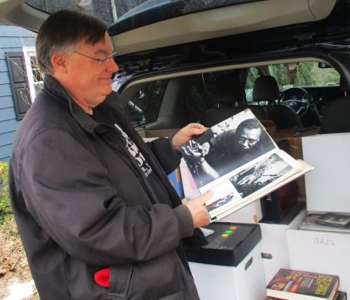 Tom Kohn with some of Eugene Kramer's collection to be displayed and sold at Bop Shop Records.