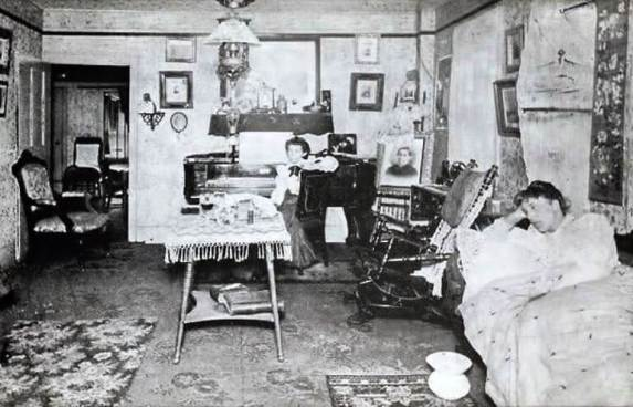 The Post's parlor. Where guests, living and dead, made themselves at home. (From the Local History Division, Rochester Public Library)