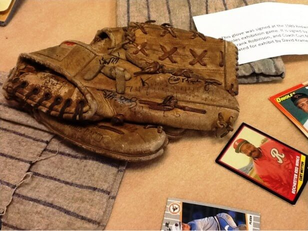 """Exhibit note: """"This glove was signed at the 1989 Redwings [sic] vs. Orioles exhibition game. It is signed by Cal Ripken Jr., Frank Robinson, and Coach Curt Motton. Donated for exhibit by David Kramer."""" [The correct date is 1988]"""