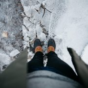 A person looking down at their feet symbolising the inwardly focused perspective of anxious thoughts.