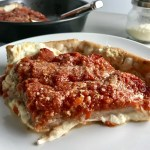 Slice of Chicago Style pizza with tomatoes on top.This Chicago Style Pizza is a lighter and healthier version, but still AMAZING! It still has all of the gooey mozzarella cheese, but uses homemade turkey Italian Sausage, that's so delicious!