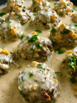 Chipotle Meatballs with Mexican Corn Cream Sauce are delicious! The meatballs are made with lean ground beef, black beans, chipotle peppers in adobo sauce, ground tortilla chips, and scallion and then baked to perfection. The creamy sauce is inspired by Mexican Street Corn with sweet corn, smoky Mexican spices, cool and tangy sour cream. Yum!