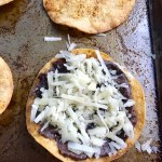 Mushroom and Black Bean Tostadas with Manchego Cheese, and Cilantro Lime Cream are crazy good! The tortillas are baked until crunchy, then topped with homemade refried black beans, nutty aged Manchego Cheese, sautéed mushrooms, and then baked until the cheese is melted. Top with cool cilantro lime cream, crisp radishes, and fresh cilantro. Simple, Gluten-Free, Vegetarian, Delicious!