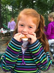 Camping With Kids Guide. Reasons to go Camping: Be a Kid again! Picture of child eating smores