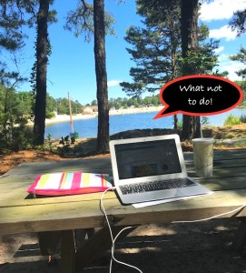 Camping With Kids Guide. Reasons to go Camping: Detach from Technology! Picture of computer on picnic bench is WHAT NOT TO DO!