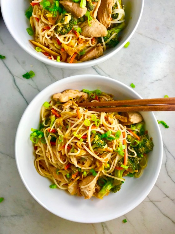 Teriyaki Peanut Sauce Chicken and Broccoli stir fry with rice noodles is a simple, delicious, one pan dinner option.  It's also Gluten Free! You get the amazing flavor from the combo of peanut butter, teriyaki sauce, and sesame oil mixed with the Chicken, Broccoli, cabbage, and rice noodles...YUM!
