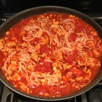 This Skillet Ground Chicken Tomato Sauce with Ricotta is a delicious and simple one pan meal.  Ground chicken is seared until it gets a super browned, flavorful crust.  Then garlic, vegetable broth and tomatoes are added and cooked down into a delightful sauce that really lets the tomato shine with a meaty bite from the chicken.  After pasta is mixed in, creamy Ricotta Cheese is dolloped on and fresh basil added to garnish.  It's perfection! Bellissimo!