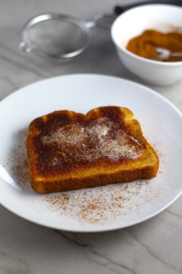 Pumpkin Spice on Buttered Toast with Spice Blend in background in bowl. Recipe has 4 simple ingredients and takes minutes to make! PLUS, here are 20 EASY WAYS TO USE this Spice blend, many with no baking at all!