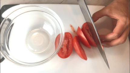 Slicing Plum Tomato for Bruschetta topping. It combines fresh tomatoes, artichoke hearts, garlic, basil, olive oil, and GOAT CHEESE! Top on toasty garlic crostini and you get fresh bright flavors with both crunch and creamy in every bite.