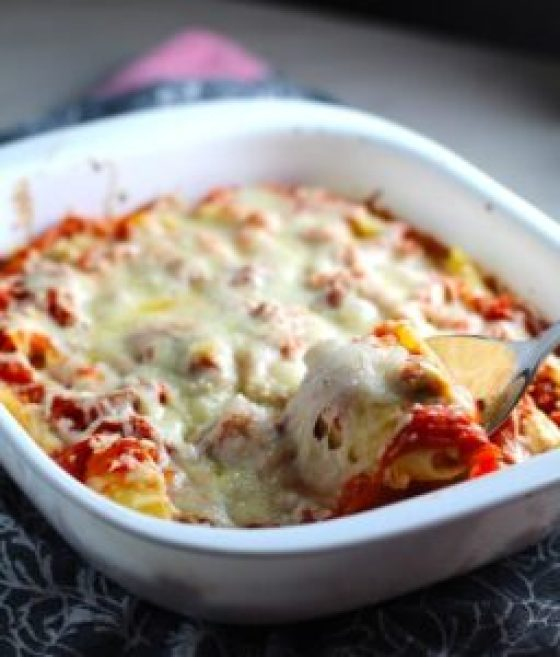 Turkey Ricotta Stuffed Shells in Tomato Sauce in casserole dish with piece scooped out. These are the perfect way to repurpose and transform leftover Turkey or Chicken. The Shredded Turkey, Italian seasonings, mozzarella, and ricotta are stuffed in shells and topped with a simple tomato sauce and more melty mozzarella and nutty parmesan, it's a perfect dish that the family will love!