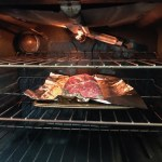 Stuffed Flank Steak in oven on center rack with broiler on. This Stuffed Flank Steak recipe is oozing with flavor! First, you get mushrooms, onions, and garlic sauteed together. Then they are mixed with fresh parsley and basil, then parmesan, and goat cheese! Roll it all up in Flank Steak and roast for an amazing dinner.