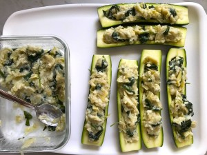 Stuffed zucchini halves for Spinach Artichoke Stuffed Zucchini. Each fantastic bite gives you creamy artichoke, nutty cheesy Parmesan, spinach, and zucchini. Prepare entirely ahead, then bake 20 minutes and enjoy! #vegetarian #zucchini #stuffedzuchini #spinach #artichoke #springrecipes #healthyfood #healthydinner #healthyrecipes #glutenfree