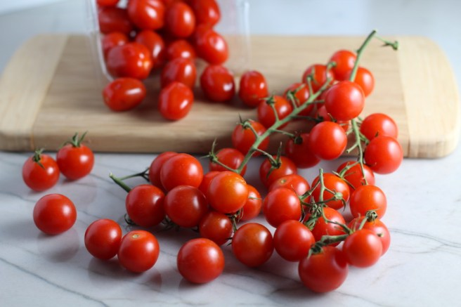 Grape and Cherry tomatoes on vine for Chicken and Cherry Tomato Pasta with basil and parmesan. It's easy and so delicious! #pasta #tomatoes #easydinner #dinner #easyrecipes #healthydinner #chicken