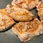 Seared chicken in skillet for Artichoke Chicken with sun dried tomatoes, basil, garlic, in cream sauce.#skilletchicken #skilletdinner #chicken #easydinner #familydinner #italian #tuscanchicken