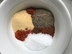 Spices separated in bowl for Smoky Pulled Beef Brisket.  It's made in the Slow Cooker and is smokey, savory, tender, moist, and full of flavor. In a delicious sauce, it goes great on a sandwich, over polenta, on rice, or potatoes. #slowcooker #crockpot #brisket #beefbrisket #pulledbeef #pulledpork