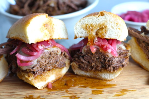 Pulled Beef Brisket Sandwich made in the Slow Cooker is smokey, savory, tender, moist, and full of flavor. In a delicious sauce, it goes great on a sandwich, over polenta, on rice, or potatoes. #slowcooker #crockpot #brisket #beefbrisket #pulledbeef #pulledpork