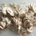 Sliced mushrooms for Chicken Stroganoff with mushrooms, and spinach. It has a thick, creamy, savory mushroom sauce with a touch of tangy sour cream. #chickendinners #chickenrecipes #familydinners #dinnerideas