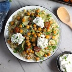 Mediterranean SHEET PAN DINNER on a plate with chicken sausage, parmesan zucchini. and crispy chickpeas over quinoa with dollops of seasoned Ricotta. #sheetpandinner #chickpeas