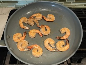 Shrimp cooking in skillet for the Orange Brown Butter Shrimp Pasta Recipe.  It has a silky sauce that's buttery, nutty, and slightly sweet! #shrimprecipes #shrimppasta #easydinners #dinnerideas