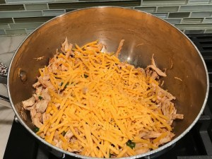 Cheese added to Shredded Chicken mixture for Chicken Taquitos. Corn tortillas are filled with smoky taco seasoned shredded chicken, and creamy cheddar cheese.  #dinnerideas #familydinner #chickenrecipes #chickendinner #tacos #taquitos