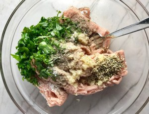 Italian Sausage ingredients in bowl for Shell Pasta with Italian Sausage and Kale. It's loaded with a salty homemade Chicken Italian Sausage flavored with garlic and fennel in a parmesan, garlic and kale sauce.