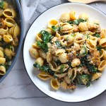 Shell Pasta with Italian Sausage and Kale on a plate. It's loaded with a salty homemade Chicken Italian Sausage flavored with garlic and fennel in a parmesan, garlic and kale sauce.