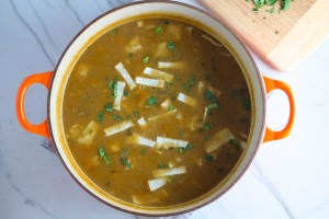 Creamy Chicken Enchilada Soup in a pot. It's creamy, hearty, slightly spicy with green chiles and smokey seasonings that bring so much depth. Corn tortilla strips act like the noodles in this soup!