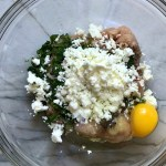 Ground Chicken Greek Meatball ingredients in a bowl. These meatballs have garlic, feta, parsley, and oregano