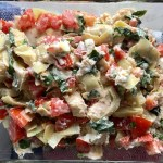 Topping added on top of chicken for Chicken Artichoke Bake with Tomatoes and Goat Cheese. It's a creamy, tangy, sweet, savory, mouth watering easy dinner that you can prep ahead!