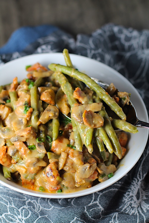 Creamy Green Beans and Mushrooms with Chorizo in a serving bowl are a creamy and savory side dish.