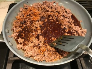 Korean Ground Beef cooked in a skillet for Korean Beef and Rice Bowls.